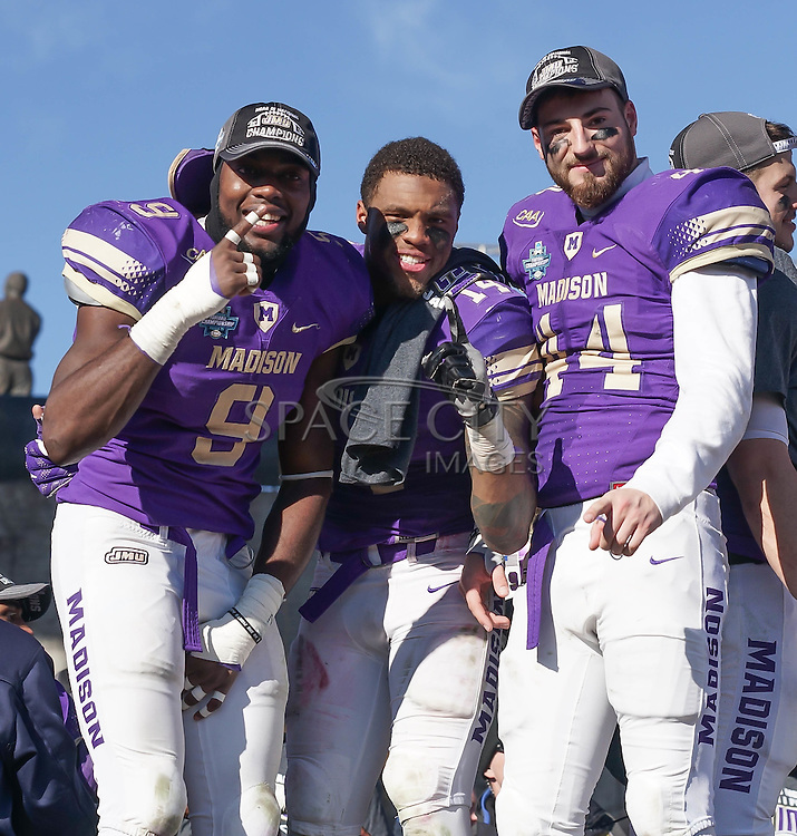 Kyle Hawkins, Taylor Reynolds, and Jordan Brown Celebrates after trophy celebration. James Madison defeated Youngstown State 28-14. January 7, 2017 Frisco, Texas. (Jerome Hicks/ Space City Images)