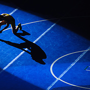 Kris Wilson/News Tribune<br /> Marceline's Dylan Wheeler casts a long shadow in the spotlight while putting on the green strap during wrestler introductions prior to his Class 1 120-pound championship match with Dalton Hembree of Seneca during the 2016 MSHSAA Wrestling State Championships at Mizzou Arena in Columbia.