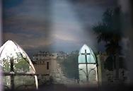 Light, reflections, and shadows in crypt, Cementerio de Colon, Havana, Cuba