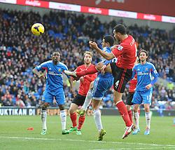 Cardiff City's Steven Caulker heads towards goal. - Photo mandatory by-line: Alex James/JMP - Tel: Mobile: 07966 386802 22/02/2014 - SPORT - FOOTBALL - Cardiff - Cardiff City Stadium - Cardiff City v Hull City - Barclays Premier League