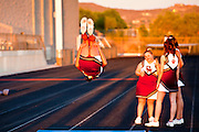 23 SEPTEMBER 2011 - SCOTTSDALE, AZ: Harper Smith, a Desert Mountain cheerleader, does a backflip before the game at Desert Mountain High School in Scottsdale. Desert Mountain played Notre Dame in Desert Mountain's homecoming high school football game.     PHOTO BY JACK KURTZ