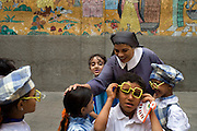 Sister Sara speaks with children readying for a special celebration at the school for poor children  that she helped found more than 30 years ago with the famous French nun, Sister Emanuel in the Manshiyet Nasser district of the Egyptian capital, Cairo October 16, 2008. The school now provides an education to more than 1200 students from the surrounding slums which are a large garbage collection district.