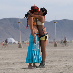 Aug. 29 2008 - Black Rock City, Nevada, USA - A couple shares a kiss on the playa near the Man, Friday afternoon, Aug. 29, 2008, during the Burning Man arts and culture festival in Black Rock City in the Black Rock Desert near Gerlach, Nev. (Credit Image: © David Calvert/ZUMA Press)
