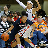Arizona's Malena Washington, left, gets away from Oregon State' Gabriella Hanson in the first half of an NCAA college basketball game in Corvallis, Ore., on Friday, Jan. 29, 2016. (AP Photo/Timothy J. Gonzalez)