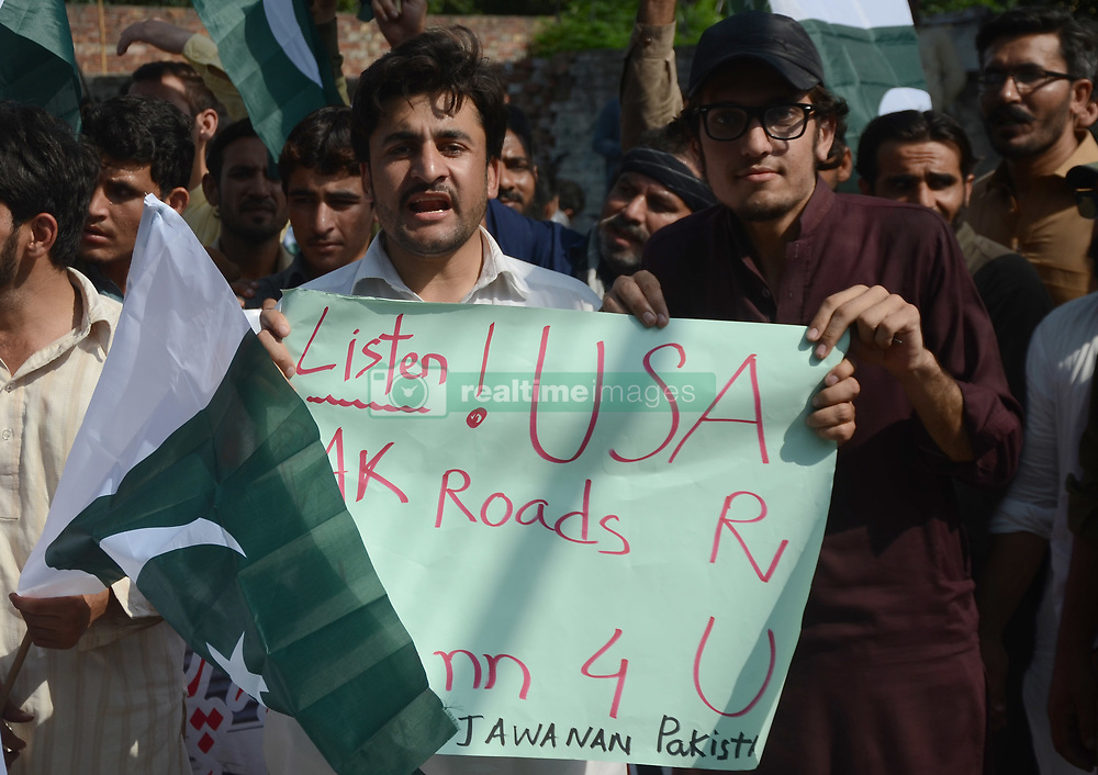 August 28, 2017 - Lahore, Punjab, Pakistan - Pakistani activists of Tehreek-e- Jawanan Pakistan torch an effigy of US President Donald Trump and the country's flag during an anti-U.S demonstration in Lahore. Pakistan's political, religious and military leaders have rejected President Donald Trump's allegation that Islamabad is harboring militants who battle U.S. forces in Afghanistan. (Credit Image: © Rana Sajid Hussain/Pacific Press via ZUMA Wire)