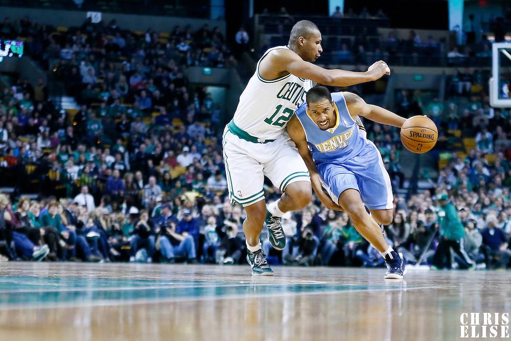 10 February 2013: Denver Nuggets point guard Andre Miller (24) drives past Boston Celtics shooting guard Leandro Barbosa (12) during the Boston Celtics 118-114 3OT victory over the Denver Nuggets at the TD Garden, Boston, Massachusetts, USA.