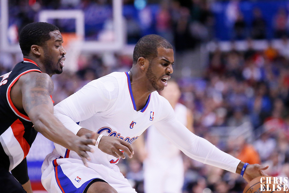 12 February 2014: Los Angeles Clippers point guard Chris Paul (3) reaches for the ball in front of Portland Trail Blazers shooting guard Wesley Matthews (2) during the Los Angeles Clippers 122-117 victory over the Portland Trail Blazers at the Staples Center, Los Angeles, California, USA.