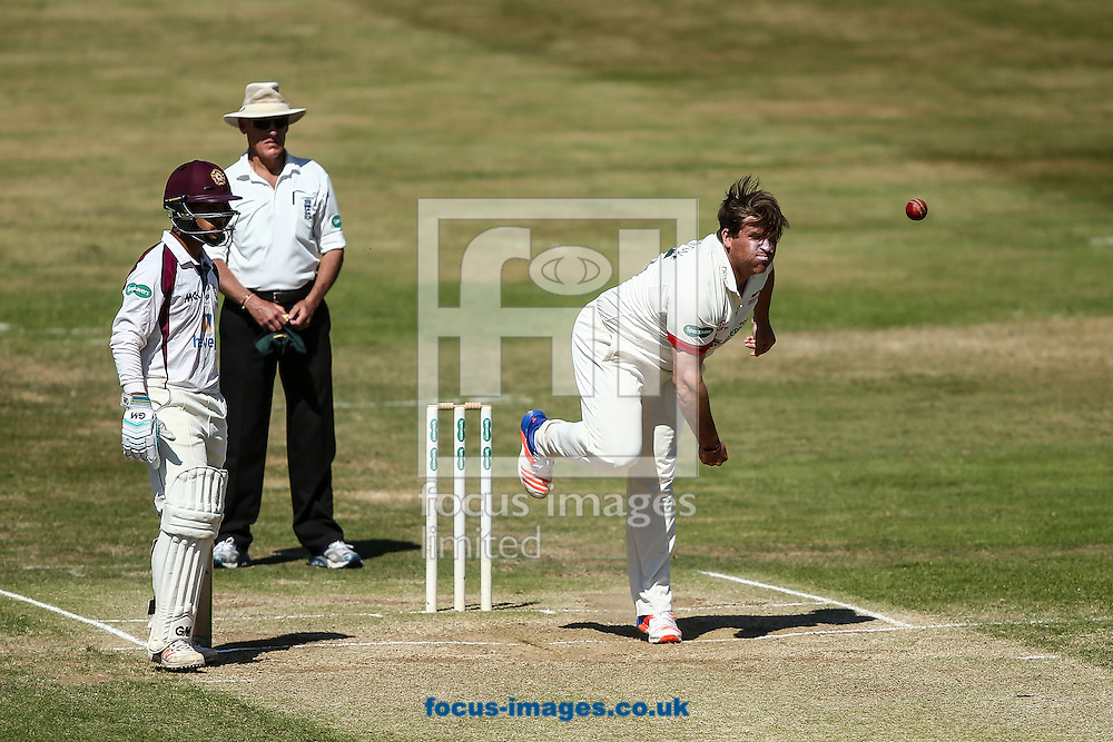 Mark Cosgrove of Leicestershire (right) in delivery stride during the Specsavers County C'ship Div Two match at the County Ground, Northampton<br /> Picture by Andy Kearns/Focus Images Ltd 0781 864 4264<br /> 15/08/2016