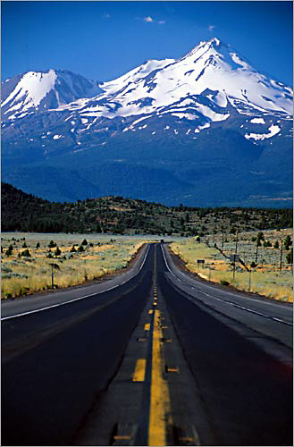 mount shasta dominates the landscape on a trip down highway 299 on a summer afternoon.<br /> <br /> highway 299 is a beautiful stretch of highway in northern california.