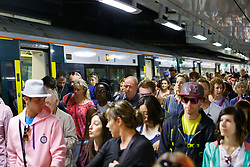 © Licensed to London News Pictures. 08/08/2016. London, UK. Southern Rail passengers arrive Victoria Station in London after travelling on overcrowded carriages, as hundreds of thousands of rail passengers face a week of travel chaos because of a five-day strike in an escalating dispute over the role of conductors between Southern Rail and the RMT Union. Photo credit: Tolga Akmen/LNP
