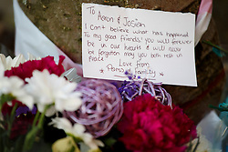 """© licensed to London News Pictures. London, UK 01/03/2014. Mourners left flowers for """"Aaron & Josiah"""" where two men, believed to be in their 20s, were found injured in a vehicle and later died in Leytonstone, east London on Saturday, 1 March 2014. Photo credit: Tolga Akmen/LNP"""