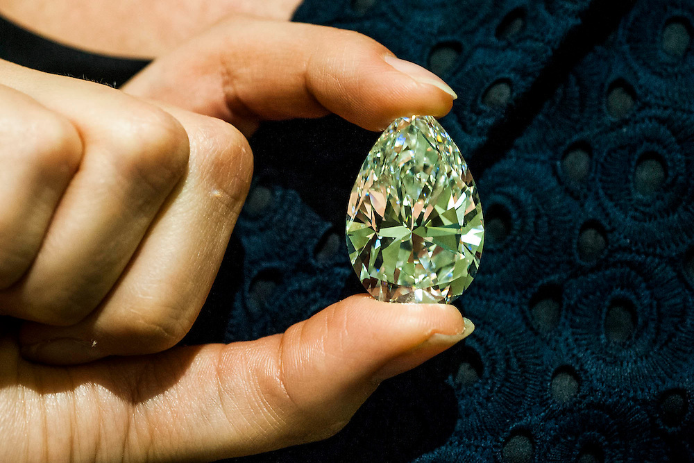 Christie's show off major pieces to be autioned in their Magnificent Jewels sale in Geneva. These include: the Blue - the largest flawless vivid blue diamond in the world, estimate $21-25m; the Rajah - a brilliant cut diamond of 26.14 carats, est $3-5m; and the Ocean Dream - the largest fancy vivid bluee-green diamond. King Street, London, UK.