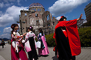 Japanese girls dressed in kimono in front of the A-Bomb Dome at Hiroshima's Peace Memorial Park.