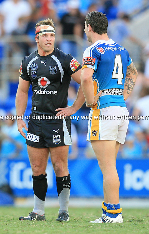 Ian Henderson and Brett Delaney have a chat at the end of the game.  Round 7 of the NRL - Gold Coast Titans v New Zealand Warriors. Played at Skilled Stadium, Robina QLD. Titans (36) defeated the Warriors (24).  Photo: Warren Keir (Photosport NZ).<br /> <br /> Use information: This image is intended for Editorial use only (e.g. news or commentary, print or electronic). Any commercial or promotional use requires additional clearance.