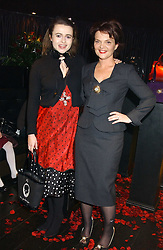 Left to right, actress HELENA BONHAM-CARTER and LULU GUINNESS  at a preview of Lulu Guinness's new Handbag Collection ' Couture' held at Aviva, Baglioni Hotel, 60 Hyde Park Gate, London SW7 on 15th February 2006.<br />