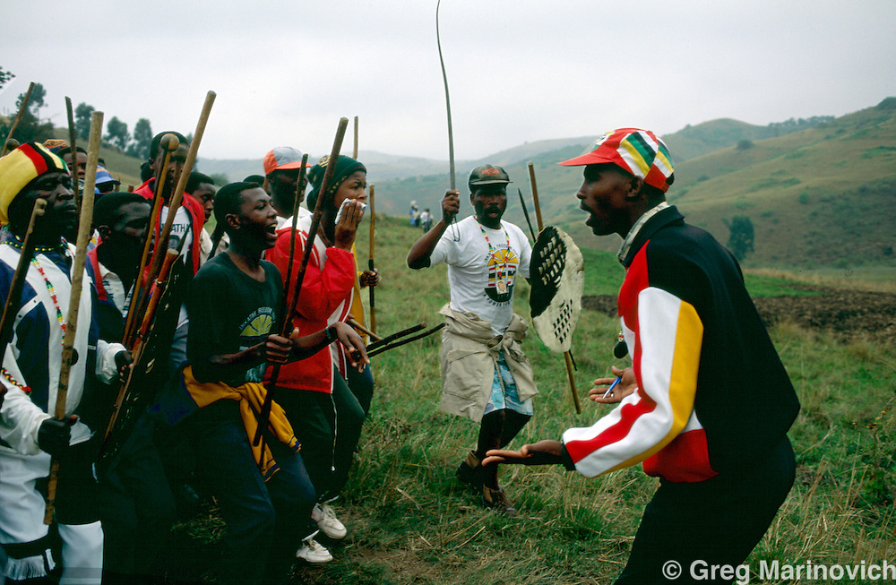 KwaZulu Natal, South Africa,  1995: The warriors led by south Coast IFP warlord Sqoloso Xolo (right) sing as they make their way through a rural area. Xolo was later assassinated in inte- IFP rivalry.