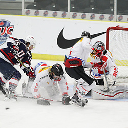 COBOURG, - Dec 16, 2015 -  Game #7 - United States vs Switzerland at the 2015 World Junior A Challenge at the Cobourg Community Centre, ON. The battle for the puck during the first period.(Photo: Tim Bates / OJHL Images)