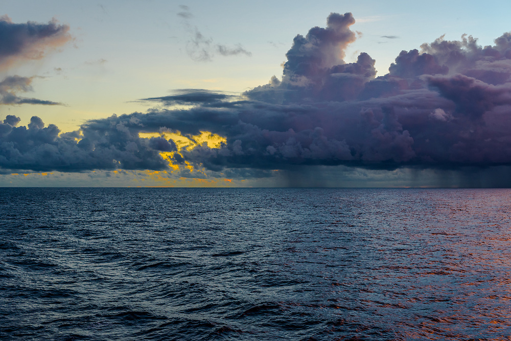 Darkness descends over the Pacific Ocean as the sun dissapears behind the clouds.
