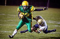 JEROME A. POLLOS/Press..Lakeland High running back Shawn Hiebert speeds past a diving Timberlake defender.