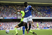 Ipswich Town defender Josh Emmanuel battles for possession during the Sky Bet Championship match between Ipswich Town and Brighton and Hove Albion at Portman Road, Ipswich, England on 29 August 2015.