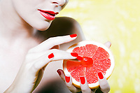 beautiful caucasian woman portrait  tease grapefruit breast concept studio on yellow background