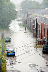 Torential downpours cause the road to flood on Butterthwaite Lane Sheffield.28 June 2012.Image © Paul David Drabble