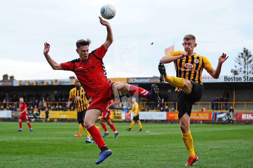 TELFORD COPYRIGHT MIKE SHERIDAN 2/3/2019 - Ryan Barnett of AFC Telford (on loan from Shrewsbury Town Football Club) battles for the ball with Ashley Jackson during the National League North fixture between Boston United and AFC Telford United at the York Street Jakemans Stadium