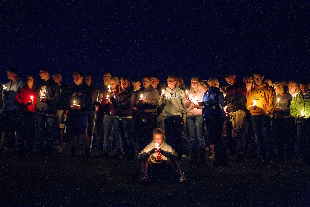 Sam Matheson sits in front of classmates, friends and family who gathered on a grassy hillside between the Coeur d'Alene High School baseball and football fields Monday to remember Devon Austin and Ryan Reinhardt who were killed in a car wreck early Sunday near Twin Falls.