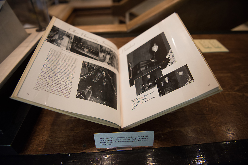 A 1944 Athena yearbook featuring a photospread of the inauguration of President Walter Sylvester Gamertsfelder, the 13th President of Ohio University on display at Alden Library.