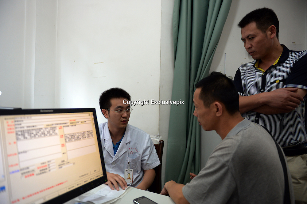 CHENGDU, CHINA - JUNE 24: (CHINA OUT) <br /> <br /> &quot;World Cup Syndrome Clinic&quot; In Chengdu Hospital Reminds Citizens To Avoid Sleep Deprivation<br /> <br /> A soccer fan consults with the medical staff in the &quot;World Cup Syndrome Clinic&quot; of No. 3 People's Hospital to soccer fans on June 24, 2014 in Chengdu, Sichuan Province of China. Over a week after the 2014 World Cup began, the No. 3 Peoples Hospital in Chengdu opened a &quot;World Cup Syndrome Clinic&quot;, specifically for soccer fans that developed health issues from staying up late to watch the World Cup. A spokesperson of the hospital says that everyday since the World Cup began, there have been patients coming in for counselling or treatment on sleep deprivation caused by staying up all night to watch the World Cup. There have also been cases when fans overeat while watching the World Cup, causing burden in the gastrointestinal tract. The spokesperson says that sleep deprivation can cause mood depression and anxiety, decreased immune function, and can easily lead to neurasthenia or flu symptoms.<br /> &copy;Exclusivepix