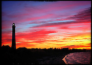 Babylon, NY,  November 10, 2016: --- The sun sets behind the Fire Island Lighthouse. The sky looks like it was painted with crayons.     © Audrey C. Tiernan