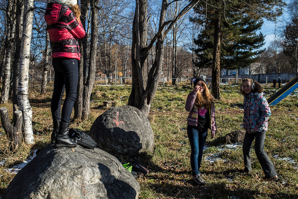 Girls hang out after school on Tuesday, October 22, 2013 in Baikalsk, Russia.