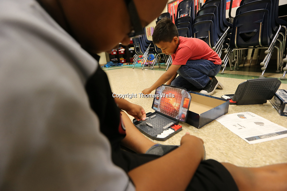 "Blake Wade, left, and Silvestre Jaimes get ready to play a game of ""Battleship"" during their last of school on Thursday at Corinth Elementary School."