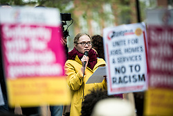 April 28, 2018 - London, United Kingdom - A woman seen giving a speech in front of the Home Office building..The Windrush generation solidarity protest gathered around 200 people at the Churchill Statue in Parliament Square to show disgust at the government's treatment of those from the Windrush generation. ''Despite the government's recent actions to attempt to rectify it, this never should have happened in the first place'', they say. (Credit Image: © Brais G. Rouco/SOPA Images via ZUMA Wire)