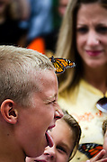 During the annual Monarch Butterfly Parade & Release in Pitman, NJ one butterfly lands on a student's head for a few minutes.