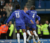 Photo: Lee Earle.<br /> Chelsea v Fulham. The Barclays Premiership. 26/12/2005. Chelsea's Didier Drogba (L) and Claude Makelele (R) congratulate Hernan Crespo (C)  after he scored their third goal.
