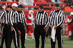 31 October 2015:  The officiating crew stands in the rain at midfield before the start of an NCAA FCS Football between Indiana State Sycamores and Illinois State Redbirds at Hancock Stadium in Normal IL (Photo by Alan Look)