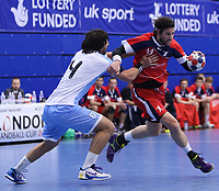 Handball - London Handball Cup 2012 - Great Britain vs. Argentina<br /> Steven Larsson of team GB takes on Sebastian Simonet of Argentina at the Crystal Palace Sports Centre