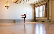 A dancer practices in the Great Hall in Memorial Union in 2013, prior to the renovations to the building. The space is used for events, weddings, and sometimes ballroom dancing or dance rehearsals.