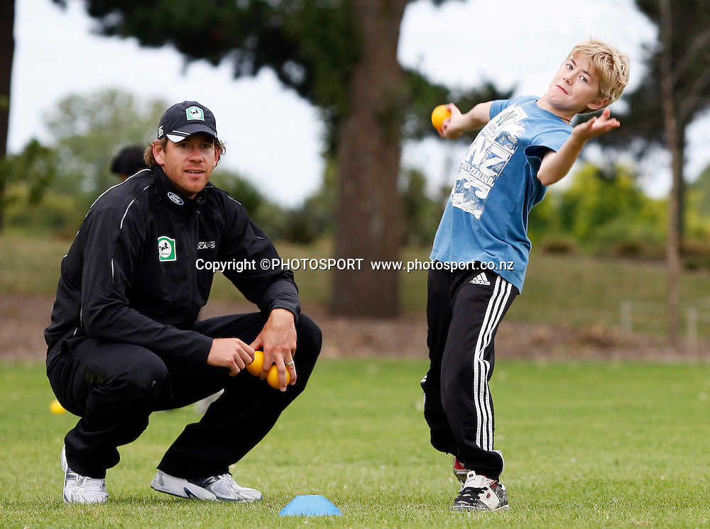 Jacob Oram help coach Ryan Campbell (12) during the intermediate bowling practice during the National Bank Super Camp, a National Bank initiative to connect with cricket's grass roots. Held at the East Shirley Cricket Club, Christchurch, New Zealand. Thursday, 27 January 2011. Joseph Johnson / PHOTOSPORT.