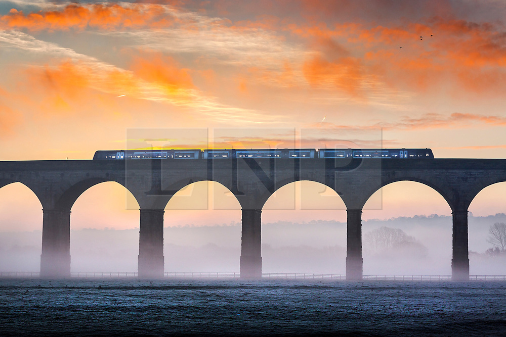 © Licensed to London News Pictures. 18/12/2019. Arthington UK. A train heading to Harrogate crosses Arthington Viaduct above the low lying fog & frozen fields near Otley in Yorkshire at Dawn this morning. Photo credit: Andrew McCaren/LNP