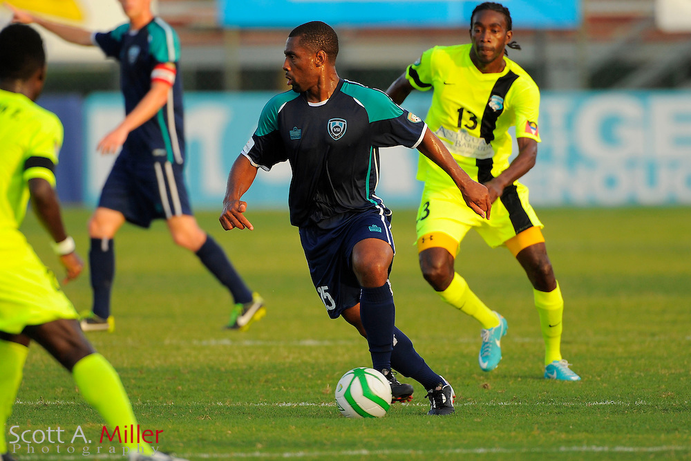 VSI Tampa Bay FC midfielder Darren Toby (15) in action against Antigua Barracuda in a USL Pro soccer match at Plant City stadium in Plant City, Florida on June 7, 2013. VSI won 8-0.<br /> <br /> &copy;2013 Scott A. Miller