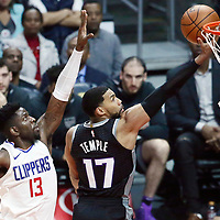 26 December 2017: Sacramento Kings guard Garrett Temple (17) goes for the layup past LA Clippers forward Jamil Wilson (13) during the LA Clippers 122-95 victory over the Sacramento Kings, at the Staples Center, Los Angeles, California, USA.