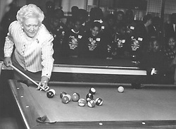 First Lady Barbara Bush plays a quick game of pool Feb. 26, 1992, during her visit to the Boys & Girls Clubs of San Antonio, 3503 Martin Luther King Dr. She is in San Antonio with President George H.W. Bush for the seven-nation drug summit that President Bush is hosting.<br />