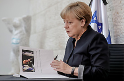 September 30, 2016 - Berlin, GERMANY - German Chancellor Angela Merkel prepares to sign the book of condolence for former Israeli President Shimon Peres at the embassy of Israel in Berlin, Germany, Friday, Sept. 30, 2016. (Credit Image: © Prensa Internacional via ZUMA Wire)