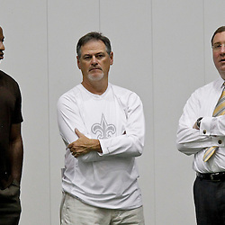 July 27, 2012; Metairie, LA, USA; New Orleans Saints general manager Mickey Loomis who also will be in charge of basketball operations for the New Orleans Hornets franchise talks with their general manager Dell Demps and team president Dennis Lauscha on the sideline during training camp at the team's indoor practice facility. Mandatory Credit: Derick E. Hingle-US PRESSWIRE