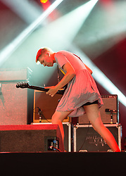 © Licensed to London News Pictures. 22/08/2014. Reading, UK.   Drenge performing live at Reading Festival 2014 on Friday, the opening day.     In this picture - Eoin Loveless, wearing a woman's dress.  Drenge is Eoin Loveless, on guitar and vocals, and his younger brother Rory, on drums.  Photo credit : Richard Isaac/LNP