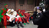Middletown, New York - A young girl gets her picture taken with Santa and his helpers at the Middletown YMCA on Dec. 4, 2010.