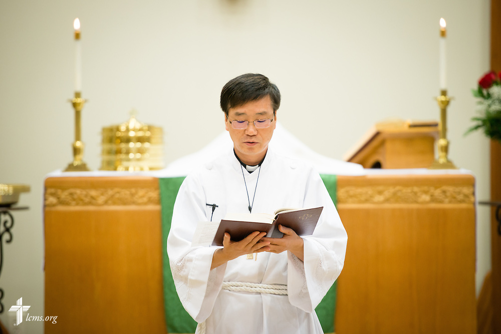 Vicar Yi Sung Chung prays during Divine Service on Sunday, Nov. 23, 2014, at Living Faith Lutheran Church in Cumming, Ga. LCMS Communications/Erik M. Lunsford