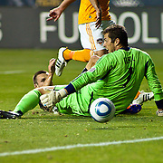 Union Attacker Jack McInerney #19 (Back) slides on the grass as the ball passes Dynamo Keeper Tally Hall #1 for a union score in the 15th minute of the first half of a MLS regular season game Saturday Aug. 6, 2011, at PPL Park in Chester PA. <br /> <br /> The News Journal/SAQUAN STIMPSON.